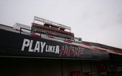 The words 'Play Like A Huskie