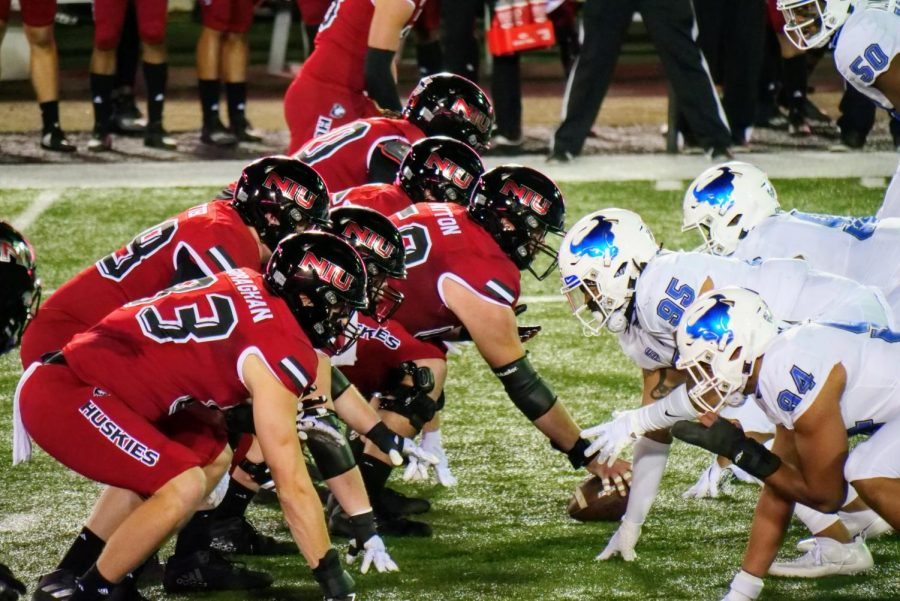 NIU's offensive line lines up against the University at Buffalo's defensive line Nov. 4, during the Huskies' 49-30 loss to the Bulls at Huskie Stadium in DeKalb