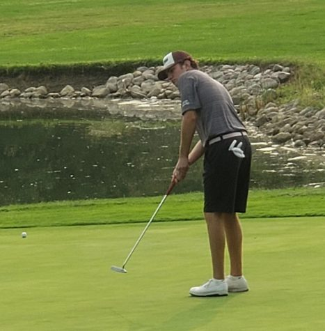 High school senior Ben Sluzas putting Sept. 14, during senior night at Big Run Golf Club.