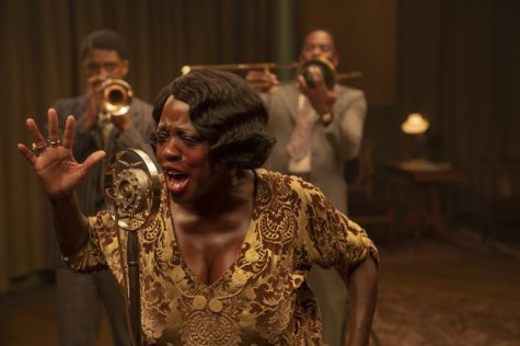 "This image released by Netflix shows Chadwick Boseman, from left, Viola Davis and Colman Domingo in ""Ma Rainey"