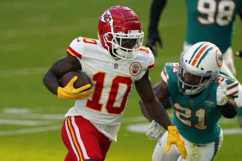 Kansas City Chiefs wide receiver Tyreek Hill (10) runs for a touchdown as Miami Dolphins free safety Eric Rowe (21) attempt to tackle, during the first half of an NFL football game, Sunday, Dec. 13, 2020, in Miami Gardens, Fla.