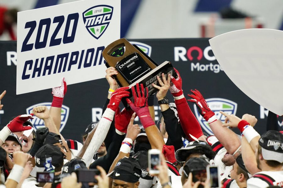 Ball+State+players+reach+for+the+trophy+after+defeating+Buffalo+in+the+Mid-American+Conference+championship+NCAA+college+football+game%2C+Friday%2C+Dec.+18%2C+2020%2C+in+Detroit.