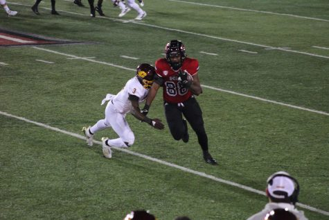 Redshirt senior tight end  Daniel Crawford attempts to evade a defender Nov. 11, during NIU