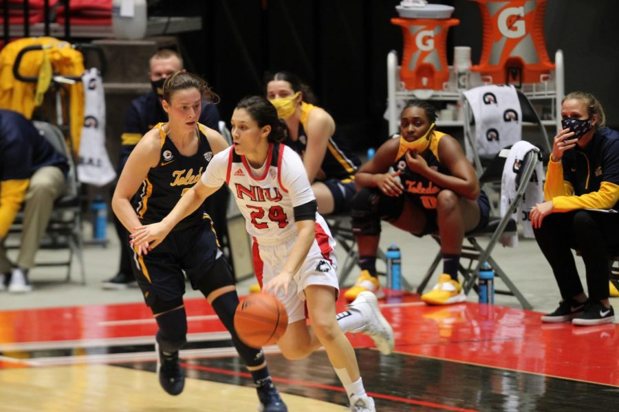 Redshirt senior guard Paulina Castro (right) drives past sophomore guard Sophia Ward Dec. 10, during NIU's 82-79 loss to the University of Toledo Rockets at the NIU Convocation Center in DeKalb.
