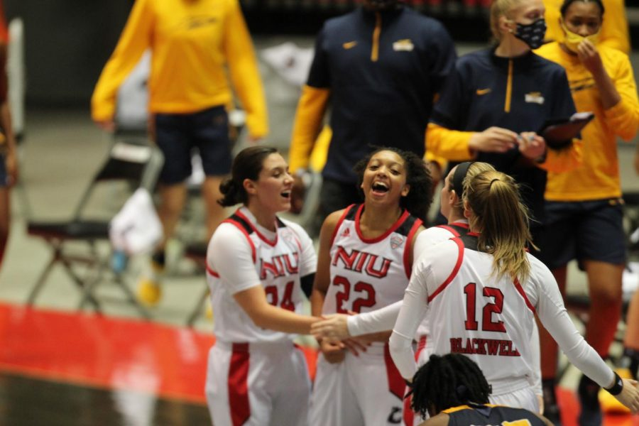 Redshirt junior guard Janae Possion (center) celebrates with redshirt senior guard Paulina Castro (left), sophomore guard Chelby Koker (second from right) and senior forward Riley Blackwell (right) Dec. 10, after making back-to-back 3-pointers during NIU's 82-79 loss to the University of Toledo at the NIU Convocation Center in DeKalb.