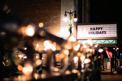 The billboard at the entrance of the Egyptian Theatre in DeKalb displays Happy Holidays.