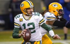 Green Bay Packers' Aaron Rodgers drops back to pass during the first half of an NFL football game against the Chicago Bears Sunday, Jan. 3, 2021, in Chicago.