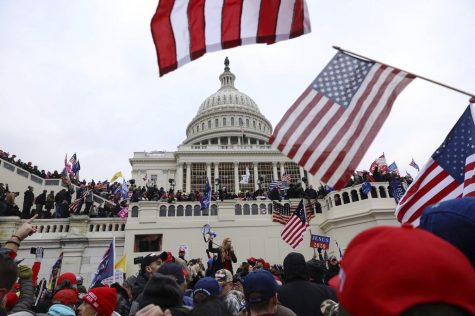 Supporters of President Donald Trump gather outside the U.S. Capitol, Wednesday in Washington.