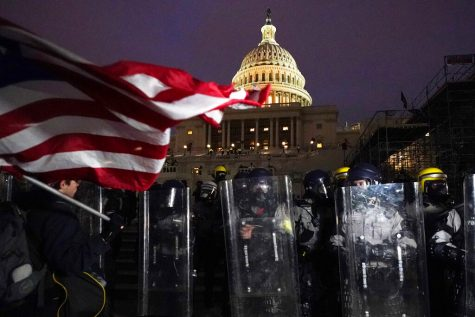 Police stand Wednesday outside the Capitol after a day of protesters rioting.