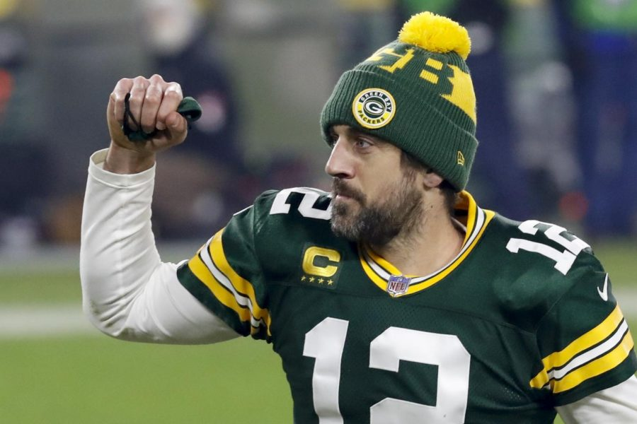 Green Bay Packers quarterback Aaron Rodgers pumps his fist Saturday after the NFL division playoff game in Green Bay, WI against the Los Angeles Rams.