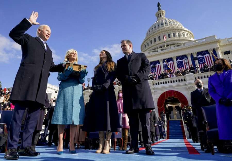 Joe Biden is sworn in Wednesday as the 46th president of the United States by Chief Justice John Roberts as Jill Biden holds the Bible during the 59th Presidential Inauguration at the U.S. Capitol.