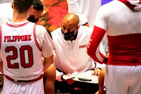 Former NIU Head Coach Mark Montgomery addresses the team during a timeout Jan. 2, during NIU