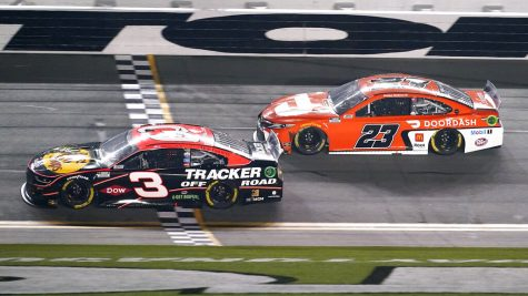 Austin Dillon (3) crosses the finish line in front of Bubba Wallace (23) to win the second of two qualifying auto races for the NASCAR Daytona 500 at Feb. 12, 2021, at Daytona International Speedway, in Daytona Beach, Florida.