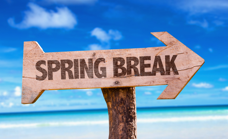 Spring Break sign with beach background