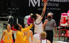 Junior forward Mikayla Brandon (second from right) attempts a layup Feb. 20, during NIU's 69-65 loss to Kent State University at the NIU Convocation Center in DeKalb.