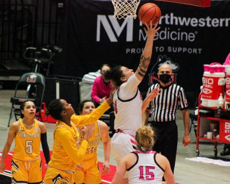 Junior forward Mikayla Brandon (second from right) attempts a layup Feb. 20, during NIU
