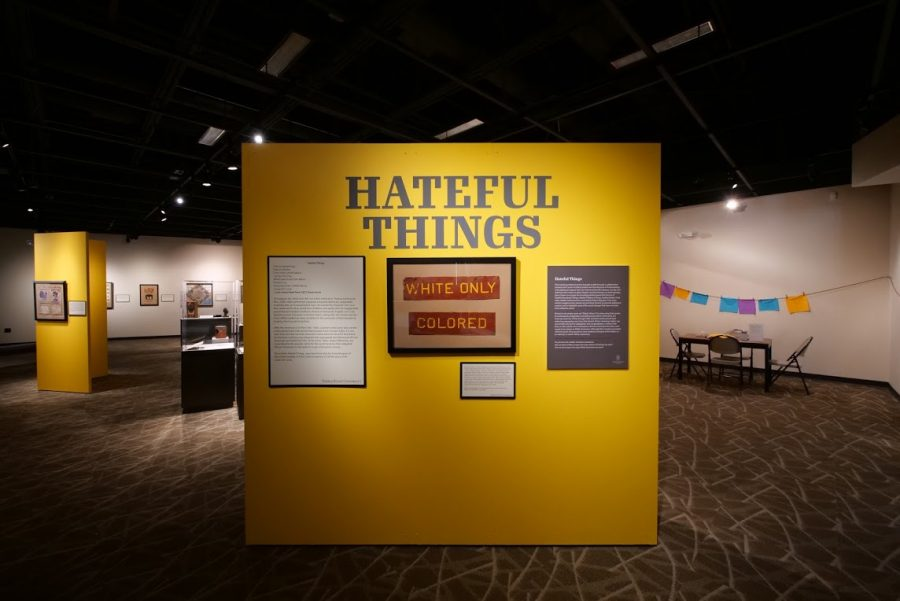 The display wall of the Hateful Things Exhibit showcases a sign saying