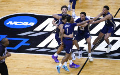 Oral Roberts University players celebrate at the end of a college basketball game against the University of Florida March 21, in the second round of the NCAA tournament at Indiana Farmers Coliseum in Indianapolis.