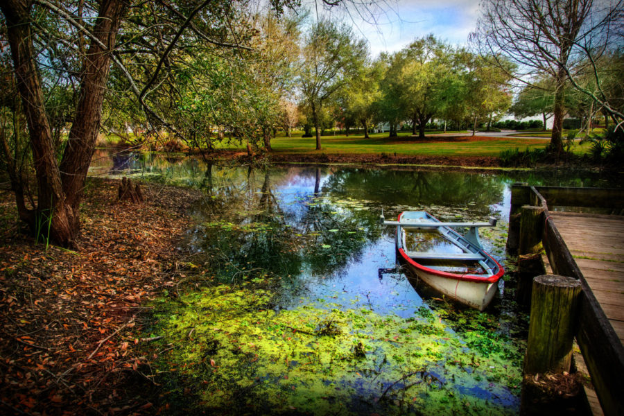 A boat sits docked on bayou of Vermillonville in Louisiana.