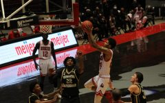 NIU junior guard Darius Beane (second from right) goes up for a layup March 2, during NIU's 73-63 loss to the Western Michigan University Broncos at the NIU Convocation Center in DeKalb.