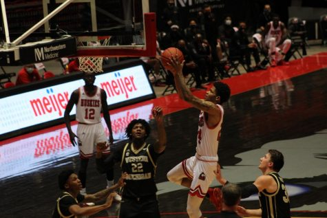 NIU junior guard Darius Beane (second from right) goes up for a layup March 2, during NIU