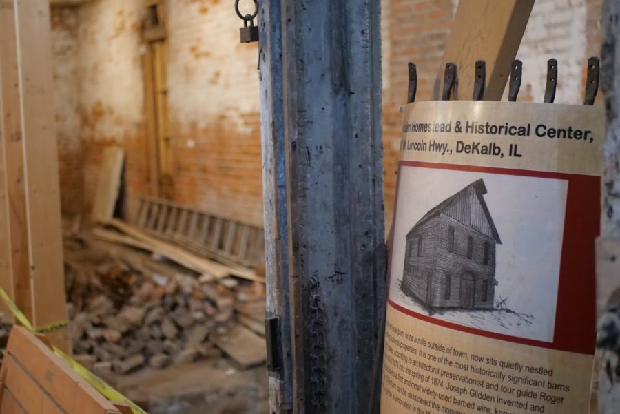 An informational poster hangs from a post inside the barn of the Glidden Homestead & Historical Center.The barn is in the process of being renovated to allow for tours of the structure.