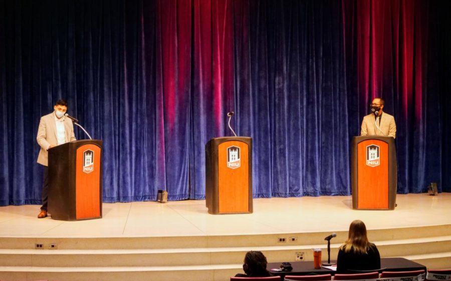NIU Student Government Association presidential candidates Brian Acosta and Devlin Collins stand at podiums Thursday during the SGA debate at the Holmes Student Center.