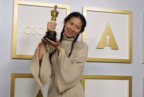"Director/Producer Chloé Zhao, winner of the award for best picture for ""Nomadland,"" poses in the press room at the Oscars on Sunday, April 25, 2021, at Union Station in Los Angeles."