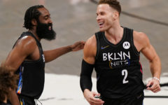 Brooklyn Nets guard James Harden (left) congratulates new teammate Brooklyn Nets forward Blake Griffin (right) March 21, after Griffin scored his first two points as a Net during the fourth quarter of an NBA basketball game against the Washington Wizards in New York.