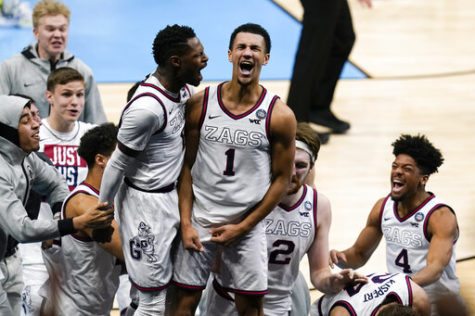 Gonzaga guard Jalen Suggs (center) celebrates making the game winning basket with Joel Ayayi (left) against UCLA April 3, during overtime in a men