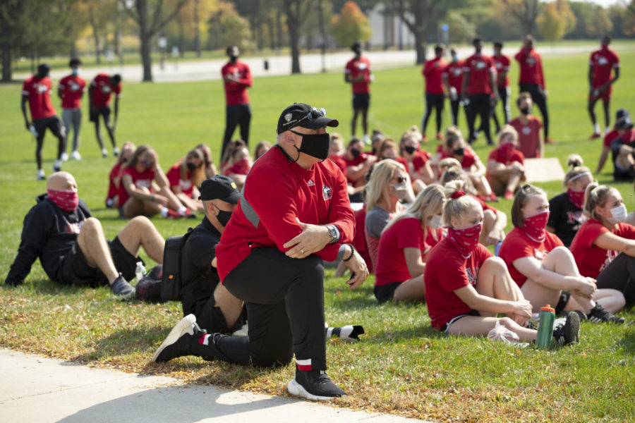 NIU Athletic Director Sean Frazier kneels outside Huskie Stadium during the student-athlete organized 'Unity March' on Oct. 10. Frazier himself was a student-athlete at the University of Alabama.