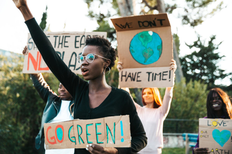 Young group of teenagers activists demonstrate against global warming.
