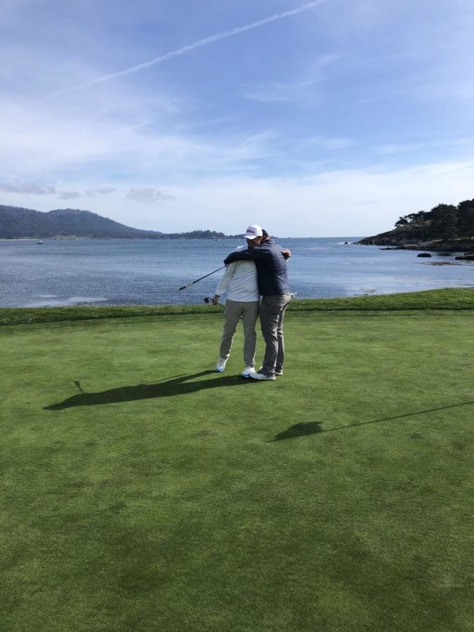 Wes Sanderson(left) and Ryan Gifford (right) celebrate completing 18-holes at Pebble Beach Golf Links on April, 4 in Monterey, California.