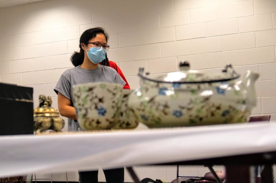 Junior, education major and vice president of Chinese Club, Hannah Schaumberg helps set up the tea ceremony.