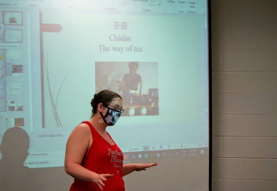 Junior psychology major and Chinese Club treasurer Sam Beightol begins her presentation on the history of tea.