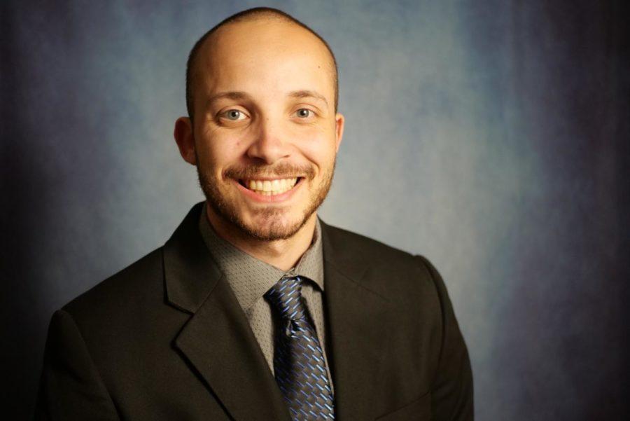 Jarrett smiles in a suit.