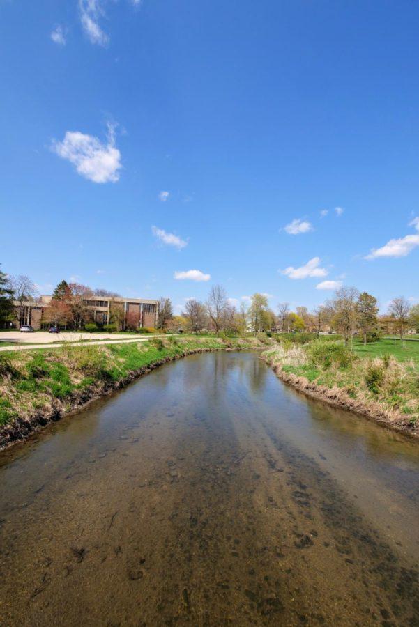 Water flows down a stream Thursday next to the NIU art building.