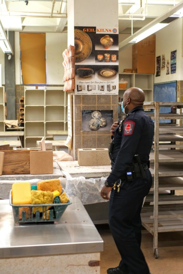 Officer Larry Williams checks a classroom Thursday in the Jack Arends Visual Arts Building. Building checks are a part of Williams daily duties.