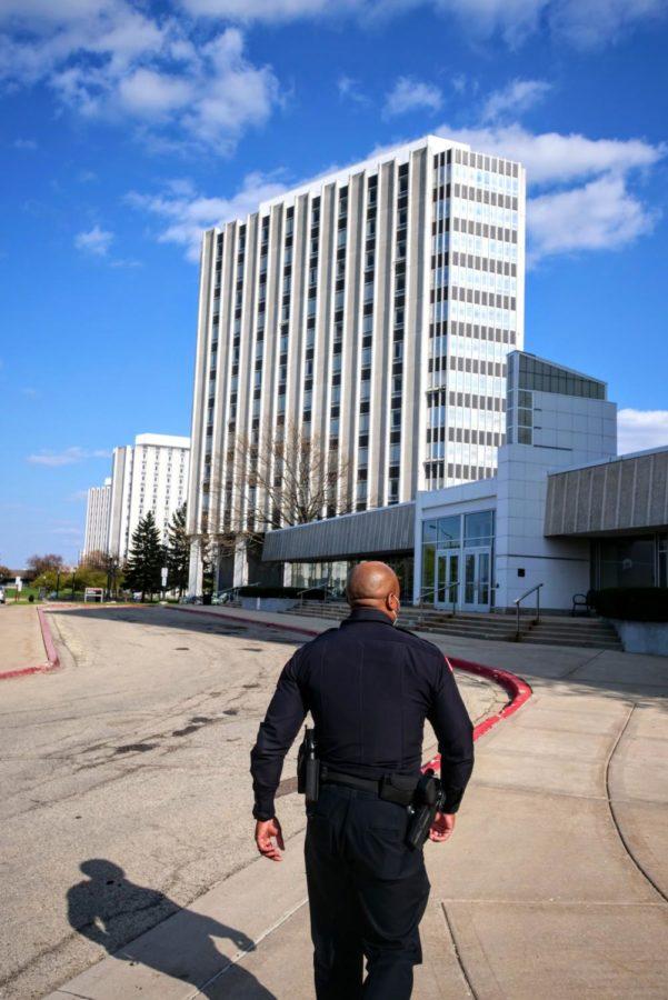 Officer Larry Williams walks to the entrance of Stevenson Towers Thursday.