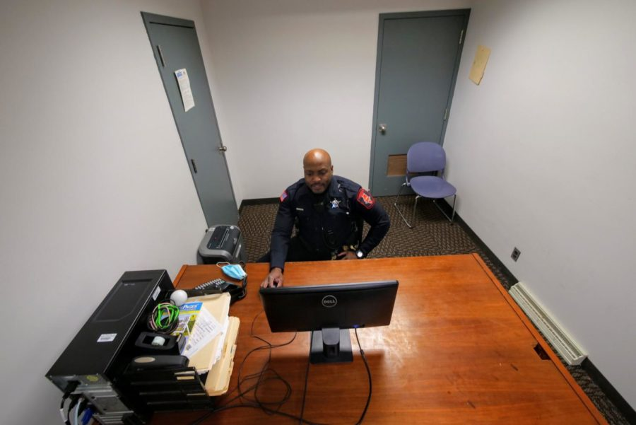 Officer Larry Williams works at a computer Thursday in Stevenson Towers. Most buildings on campus have an office for NIU police officers to work from.