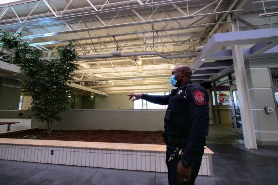 Officer Larry Williams walks down the main level of Stevenson Towers Thursday.