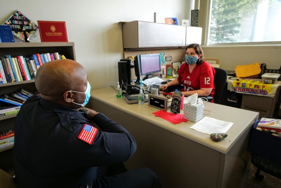 Officer Larry Williams talks to residence hall director Lindsey Komes. Officer Williams helps both students and staff in the residence halls on a regular basis.