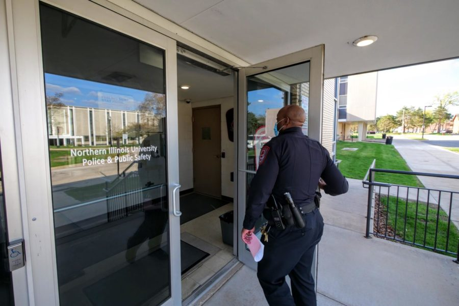 Officer Larry Williams walks through the door of the Telephone and Security building. This is where the NIU Police's dispatch center is located.