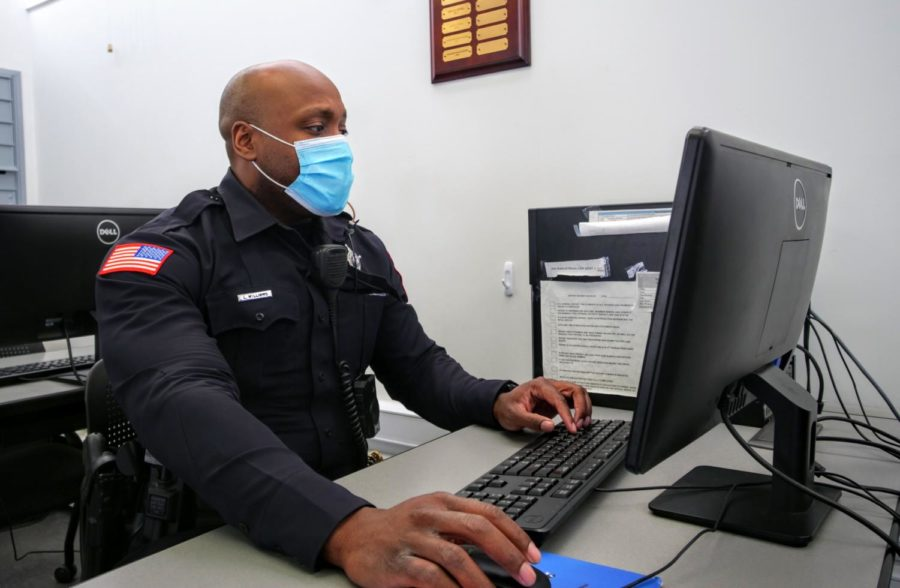 Officer Larry Williams works at a computer Thursday at the NIU police department. A majority of daily police work is desk work.