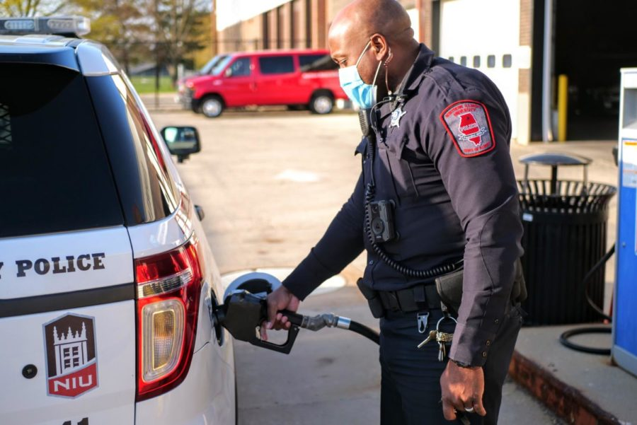 Officer Larry Williams fills up his squad car's gas tank Thursday and the transportation center off Stadium Drive.