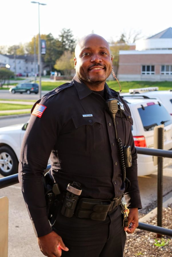 NIU police officer Larry Williams stands out front of the NIU police department Thursday.