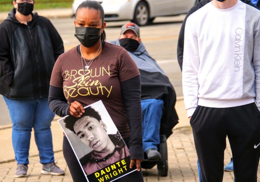 DeKalb resident Jessica Webb holds a photo of Daunte Wright Friday at Memorial Park in DeKalb.