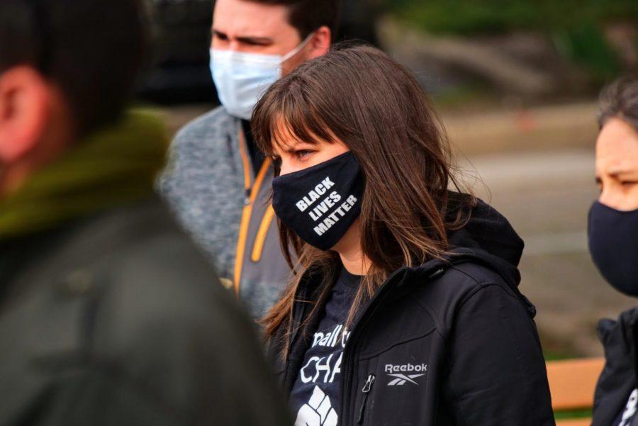 DeKalb community member wears a Black Lives Matter face mask Friday while attending a vigil in Memorial Park.