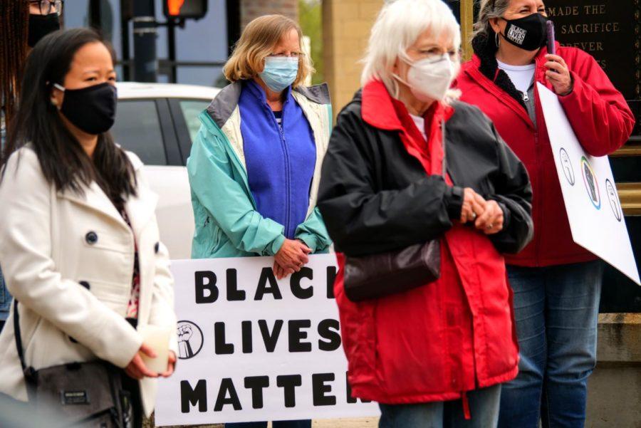 Community members listen to Jocelyn Santana speak Friday during a vigil at Memorial Park in DeKalb.