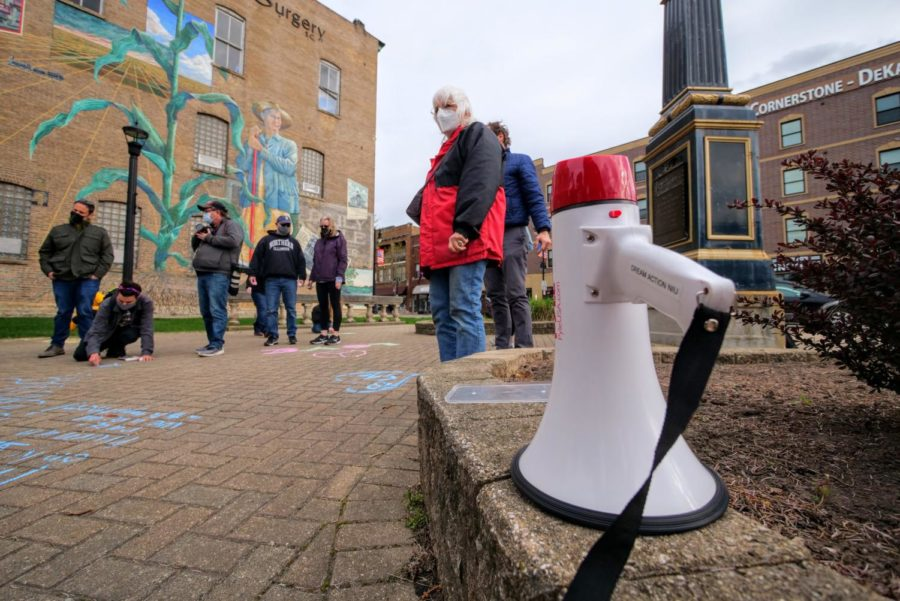 A megaphone sits on a stone wall Friday during a vigil at Memorial Park.